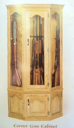 amish oak corner gun cabinet with carousel and locking storage.