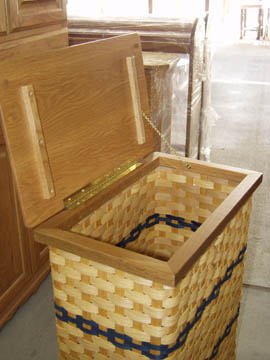 Inside view of solid oak and wicker clothes hamper