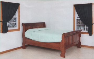 Amish made solid cherry sleigh style raised panel bed
